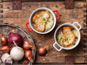 Onion soup with dried bread and cheddar cheese